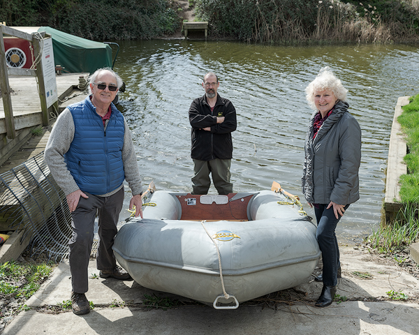 Mike and Julia Enderby photographed with Middle Level Watermen's Club Acting Commodore, Colin Ovenden (Centre) and the Zodiac inflatable boat that they presented to the MLWC in memory of Julia's late father Derek.