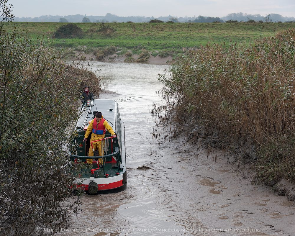 John Revell using Olive Emily's prop to reverse dredge through the silt into the Old Bedford sluice.